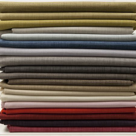 Clarke and Clarke -  Linoso Fabric Collection - Stacks of linen in colours of gold, red, pink, white, grey and blue