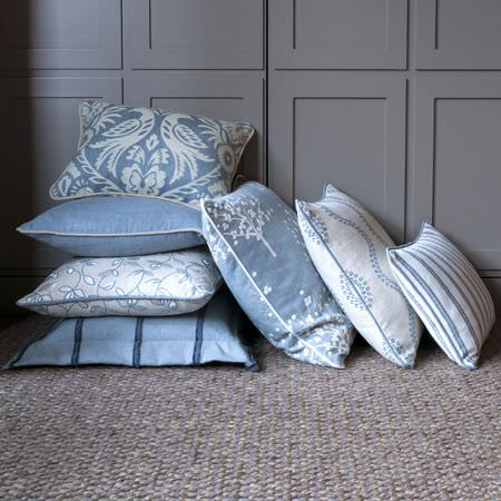 Clarke and Clarke -  Manor House Fabric Collection - Seven square scatter cushions in pale blue and white, each with a different plain, patterned, striped or floral design