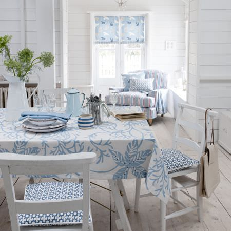 Clarke and Clarke -  Maritime Prints Fabric Collection - Blue and white bird patterned roman blind, modern floral print tablecloth and seat cushions