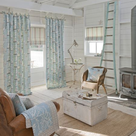 Clarke and Clarke -  Maritime Prints Fabric Collection - Pale blue boat print curtains, striped roman blinds and patterned cushions