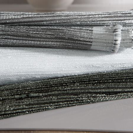 Clarke and Clarke -  Matka Fabric Collection - A roll of black, white and grey fabric with a rough, textured weave