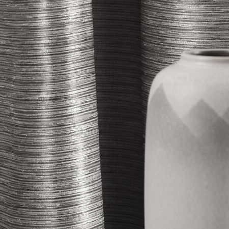 Clarke and Clarke -  Matka Fabric Collection - Detail of a vase and shiny, striped curtains