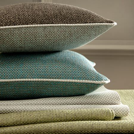 Clarke and Clarke -  Maximus Fabric Collection - Brown and blue woven cushions and green fabric