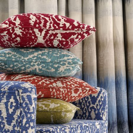 Clarke and Clarke -  Mirador Fabric Collection - Tribal style patterns printed in burgundy, sky blue, burnt orange, olive green and Royal blue, on 4 cushions and an armchair