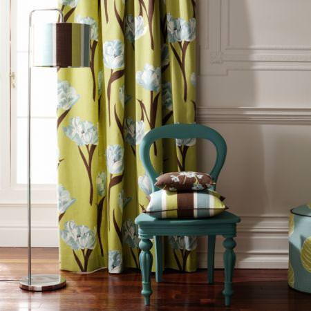 Clarke and Clarke -  Miyako Fabric Collection - Green curtain with blue modern flower pattern and brown striped and floral cushions