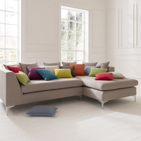 Clarke and Clarke -  Nantucket Fabric Collection - Large, square, stone coloured corner sofa, with assorted square and rectangular scatter cushions in different coloured plain fabrics