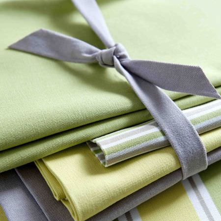 Clarke and Clarke -  New England Fabric Collection - Detail of cotton fabric in colours of yellow, grey and green, striped or plain, all tied together