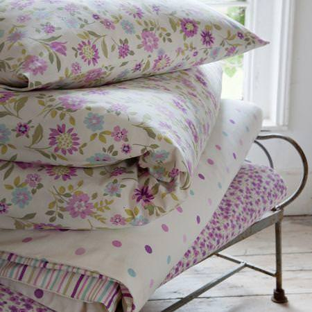 Clarke and Clarke -  Nostalgic Prints Fabric Collection - White and purple floral cushion and duvet cover with polka dot throw