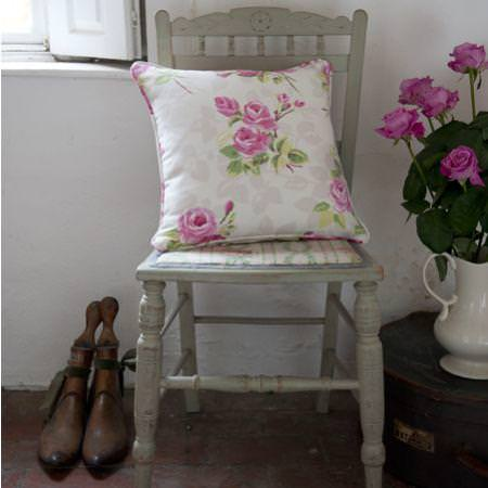 Clarke and Clarke -  Nostalgic Prints Fabric Collection - White and pink country floral cushion on green painted wooden chair
