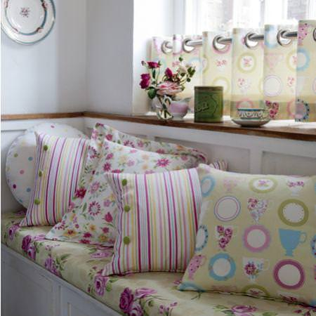 Clarke and Clarke -  Nostalgic Prints Fabric Collection - Pink and green striped, floral, spotted and cup n saucer patterned cushions and window seat