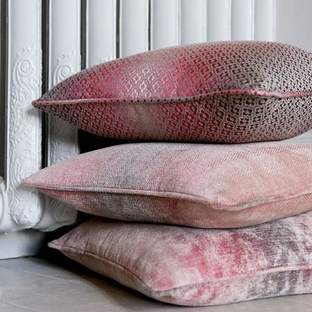 Clarke and Clarke -  Palladio Fabric Collection - A stack of three patterned and unevenly coloured square scatter cushions, made in purple, light pink and grey shades