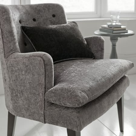 Clarke and Clarke -  Portfolio Fabric Collection - Armchair covered in grey velvet effect fabric, with long dark wood legs, a dark grey-brown cushion, and a round grey wooden occasional table