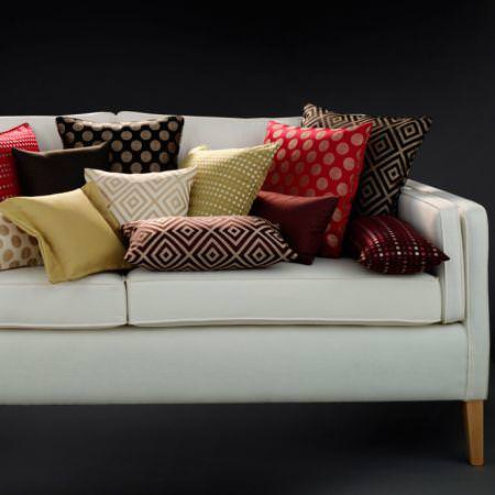Clarke and Clarke -  Quantum Fabric Collection - Spot and square patterned brown, cream red and green cushions