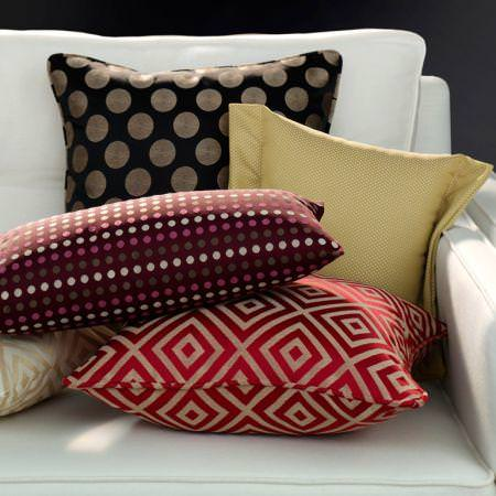 Clarke and Clarke -  Quantum Fabric Collection - Brown and red patterned cushions