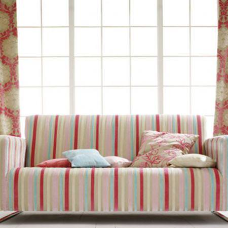 Clarke and Clarke -  Regency Velvets Fabric Collection - Striped velvet sofa with various cushions and red and neutral patterned curtains