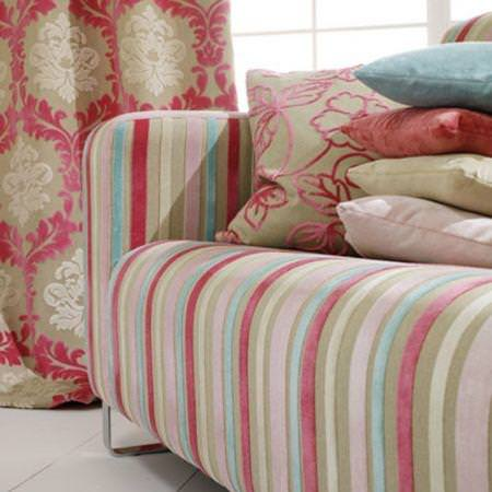 Clarke and Clarke -  Regency Velvets Fabric Collection - Classic pink and gold floral curtain with pink and blue striped couch upholstery and pillows