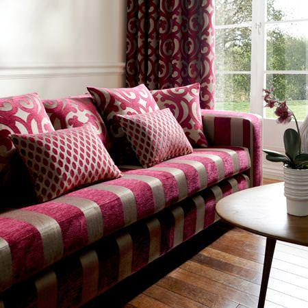 Clarke and Clarke -  Renaissance Fabric Collection - Deep red and brown upholstered couch and a Renaissance decorated curtain and cushions