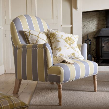 Clarke and Clarke -  Ribble Valley Fabric Collection - Armchair with wide blue and green stripes and narrow white stripes, with one patterned cushion, one floral cushion and one checked cushion