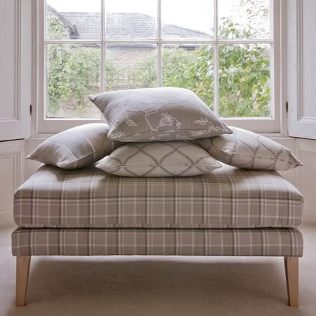 Clarke and Clarke -  Ribble Valley Fabric Collection - Large grey and cream checked footstool, with grey and cream striped and floral cushions, and two cream cushions with a grey curving pattern