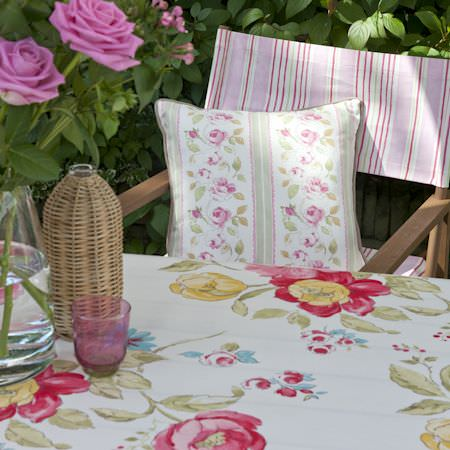 Clarke and Clarke -  Romance Fabric Collection - Garden chairs with pink striped fabric and a cushion and tablecloth with country flower design