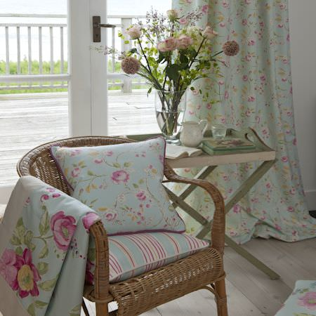 Clarke and Clarke -  Romance Fabric Collection - Duckegg blue curtains and cushions with pink roses giving a summer feeling