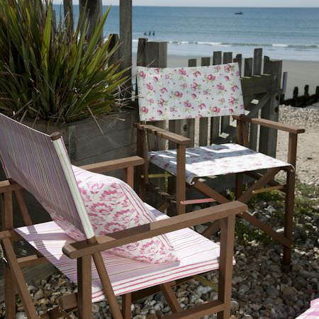 Clarke and Clarke -  Romance Fabric Collection - Folding chairs with pink striped and duck egg blue fabric with a pink carnation decorated cushion