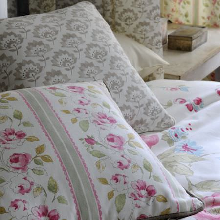 Clarke and Clarke -  Romance Fabric Collection - White cushions and bedding with pink watercoloured roses and grey carnations
