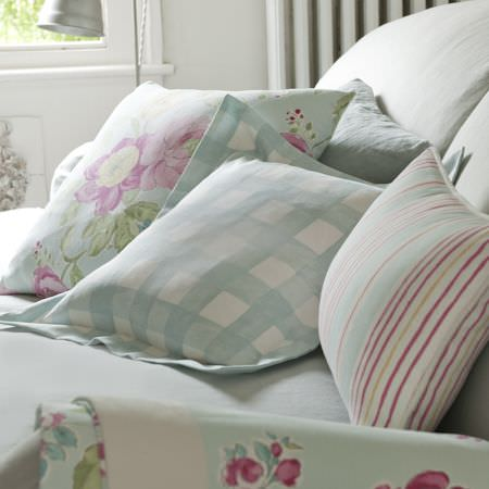 Clarke and Clarke -  Romance Fabric Collection - Duckegg blue cushions with a striped or plaid design and roses on white bedding
