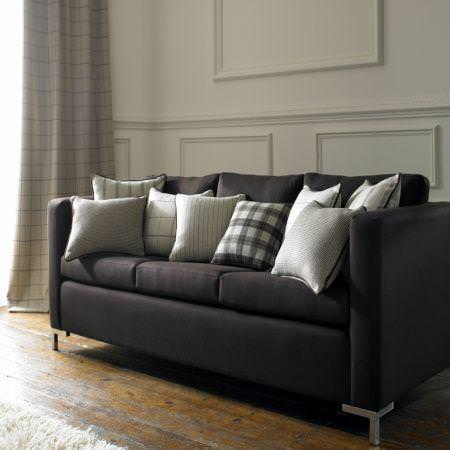 Clarke and Clarke -  Sartorial Wools Fabric Collection - Black upholstery and white plaid and striped pillows from the Sartorial wools fabric collection