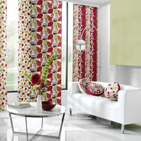 Clarke and Clarke -  Scandia Fabric Collection - White curtains with red and green foliage designs, cushions with modern flower design and couch