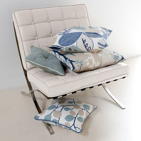Clarke and Clarke -  Scandia Fabric Collection - White seating pads on folding chair and cushions with various simple woodland designs