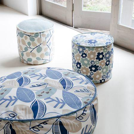 Clarke and Clarke -  Scandia Fabric Collection - Blue and white footstools with modern foliage and flower designs