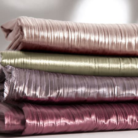 Clarke and Clarke -  Silky Fabric Collection - Folds of shiny fabric in colours of pink, gold, red and purple