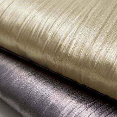 Clarke and Clarke -  Silky Fabric Collection - Folds of shiny fabric in colours of gold and purple