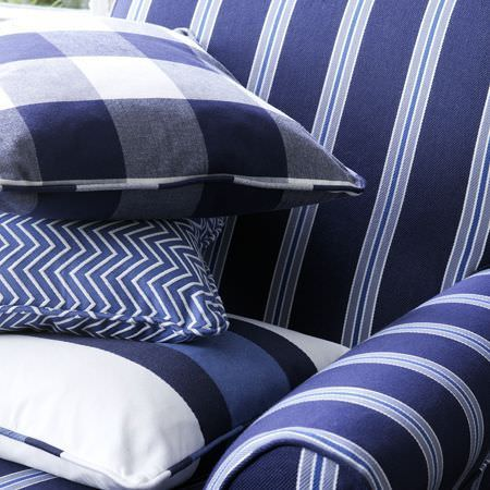 Clarke and Clarke -  Sonoma Fabric Collection - Sofa featuring wide royal blue stripes and narrow light blue and white stripes, with matching striped, zigzag and checked scatter cushions