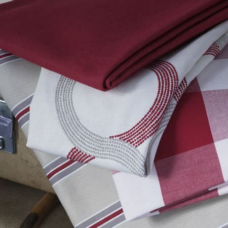 Clarke and Clarke -  Sonoma Fabric Collection - Deep red fabric, white fabric with grey and red embroidered swirls, red and white checked fabric, cream, grey, red and white striped fabric