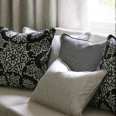 Clarke and Clarke -  Sonoma Fabric Collection - Monochrome cushions in geometric floral patterns, small checks, a stone effect print and matching curtains, with an off-white sofa