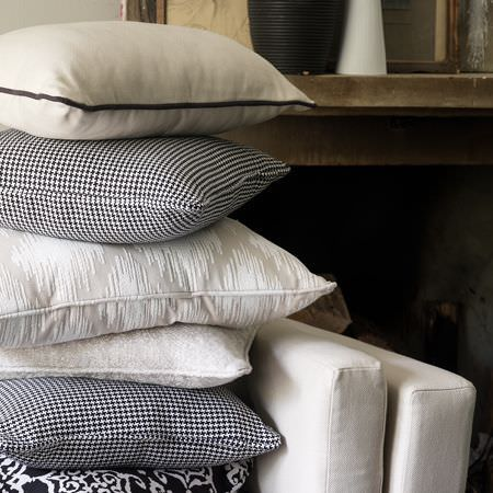 Clarke and Clarke -  Sonoma Fabric Collection - 2 off-white seat cushions, 1 cream cushion, 2 black and white checked cushions, 2 textured cream cushions, 1 black/white patterned cushion