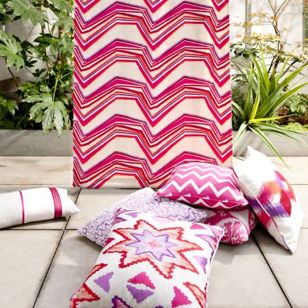 Clarke and Clarke -  South Beach Fabric Collection - Cream fabric with red and pink jagged stripes, and red, pink, purple and cream zigzag, Aztec print, striped and patterned cushions