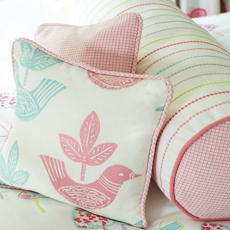 Clarke and Clarke -  Storybook Fabric Collection - Scatter and bolster cushions with checks, dotted lines and birds, on patterned fabric, all in white, pink, blue and green