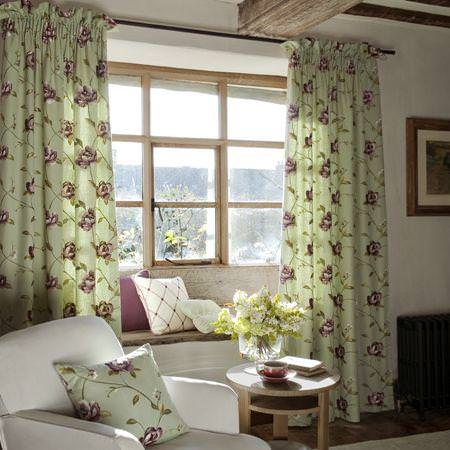 Clarke and Clarke -  Tatton Linens Fabric Collection - Light green curtains and pillow with purple grid of roses and purple cushions in window niche