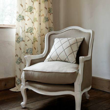 Clarke and Clarke -  Tatton Linens Fabric Collection - Linen upholstery on antique chair with cushion and a white curtain with blue stitched flowers