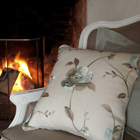 Clarke and Clarke -  Tatton Linens Fabric Collection - Pillow with stitched flower pattern on linen upholstered antique chair