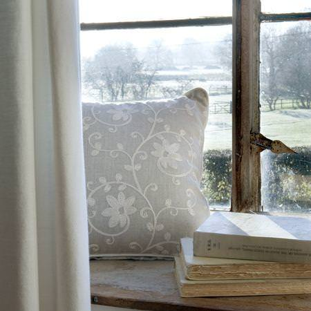 Clarke and Clarke -  Tatton Linens Fabric Collection - Antique style linen cushion with simple floral design and linen curtain