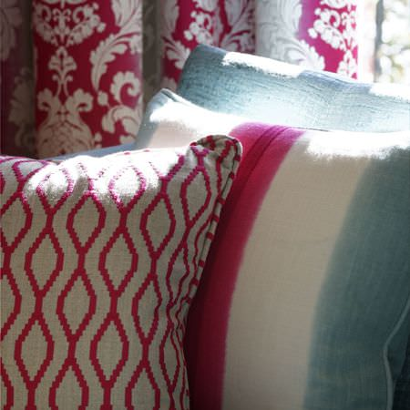 Clarke and Clarke -  Traviata Fabric Collection - A plain light blue cushion, a pink and white patterned cushion, and a cushion striped in pink, white and light blue