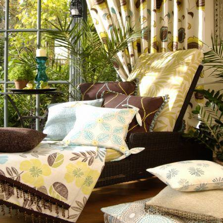 Clarke and Clarke -  Tropicana Fabric Collection - Cushions, curtains and deck chair padding with tropical flower and leaf decoration