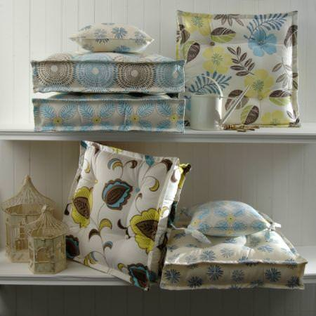 Clarke and Clarke -  Tropicana Fabric Collection - Seating pads and small cushions with tropical flower design in blue and yellow