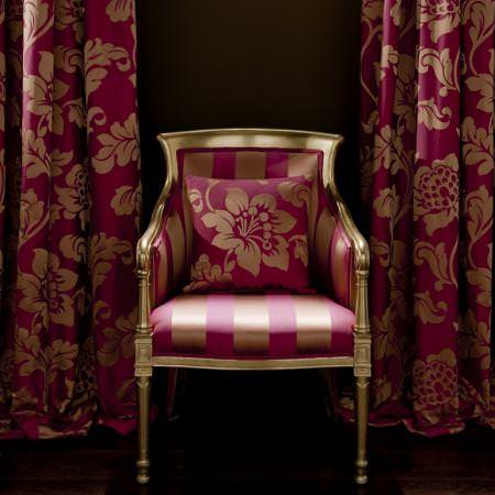 Clarke and Clarke -  Venetian Silks Fabric Collection - Antique chair with silk red and gold upholstery, and cushion and curtain with classic floral design