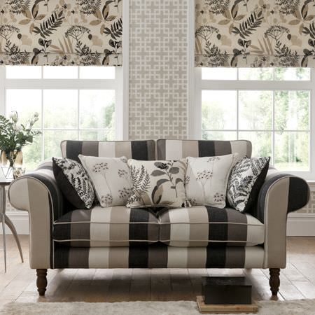 Clarke and Clarke -  Wild Garden Fabric Collection - Roman blinds, upholstery and cushions with striped and floral patterns in black, white and grey in a living room