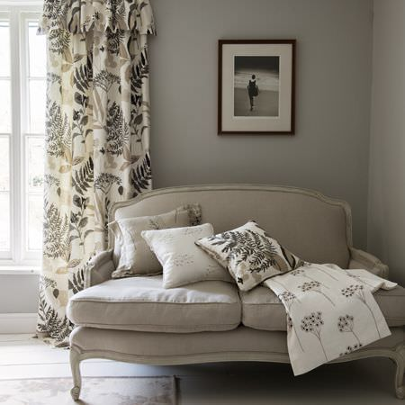 Clarke and Clarke -  Wild Garden Fabric Collection - Valance, curtains, cushions and a throw of floral fabric in black, white and grey in a monochromatic setting